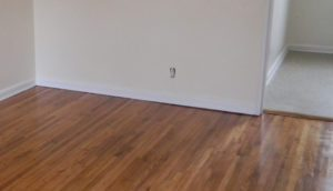 wooden floor with gap between molding