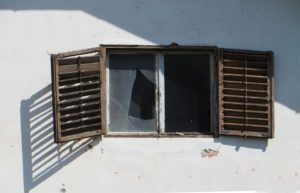 crooked window frame and broken window
